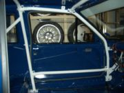 Front roll cage leg and door bar